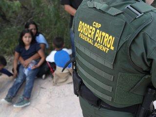 DOJ loses bid to change migrant detention rules